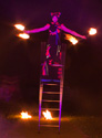 free standing ladder balance while fire spinning, australia