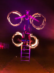 free standing ladder balance, fire arts, circus